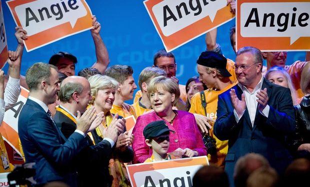 Rotundo triunfo de Merkel, que roza la mayoría absoluta