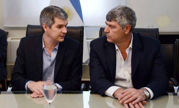 De izquierda a derecha: Marcos Peña y Ricardo Buryaile.