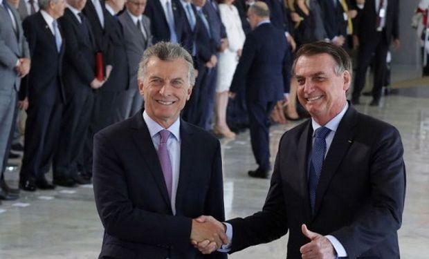 Macri en Brasilia, junto a Jair Bolsonaro.