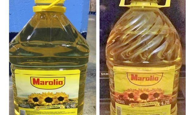 Aceite de girasol Marolio. Genuino el de la derecha y falsificado el de la izquierda.